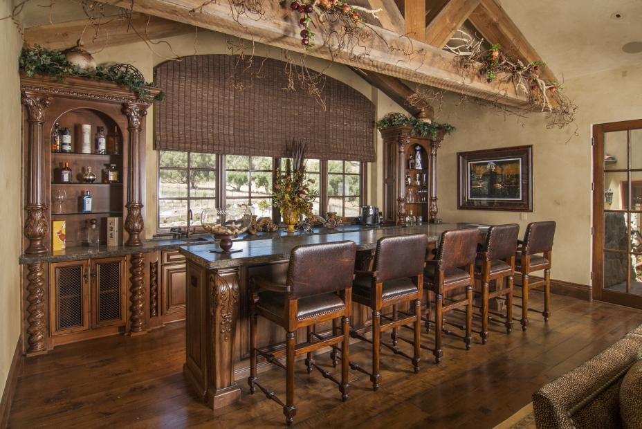 Rustic, Traditional Bar with a Beautiful Matching Island, Granite Counter tops and Decorative Columns - Posts