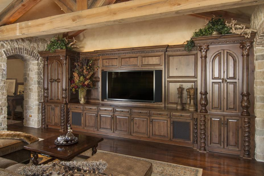 Beautiful, Rustic Traditional Entertainment Center with Wire Mesh Doors and Decorative Posts