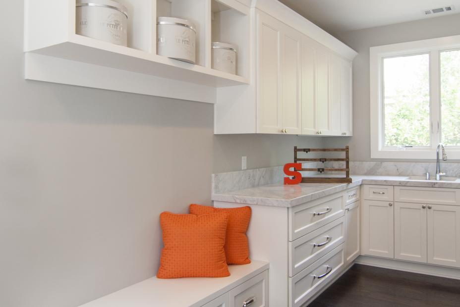 Transitional White Laundry Room with a Bench Seat, Marble Counter Tops and an LG Washer - Dryer