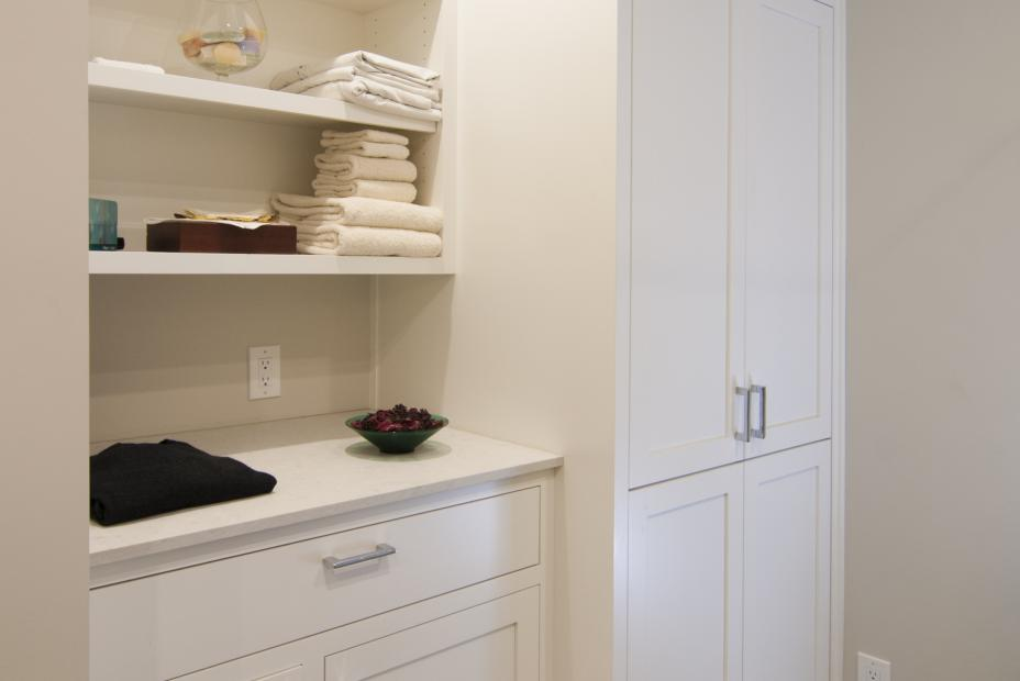Beautiful White Transitional Laundry Room Cabinets with Two Open Shelves and Silver Pulls