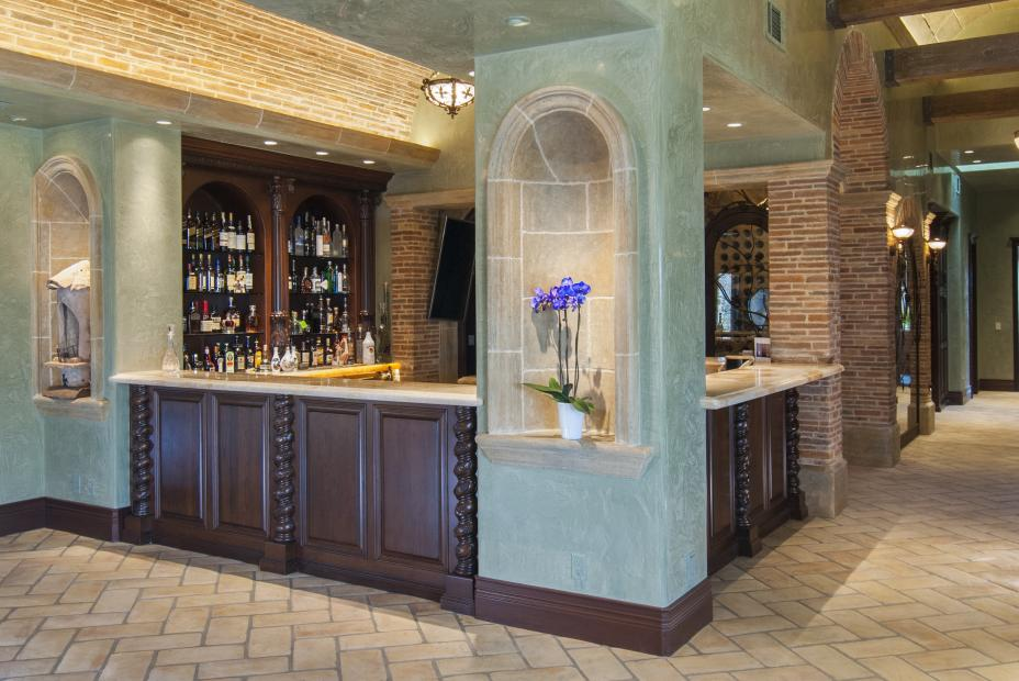 Beautiful Traditional Bar Cabinets with Ornate Decorative Posts, Glass Shelves and Granite Counter Tops