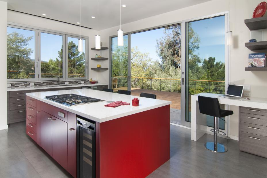 Contemporary Kitchen with a Beautiful Red Island, White Counter Top and Floating Shelves