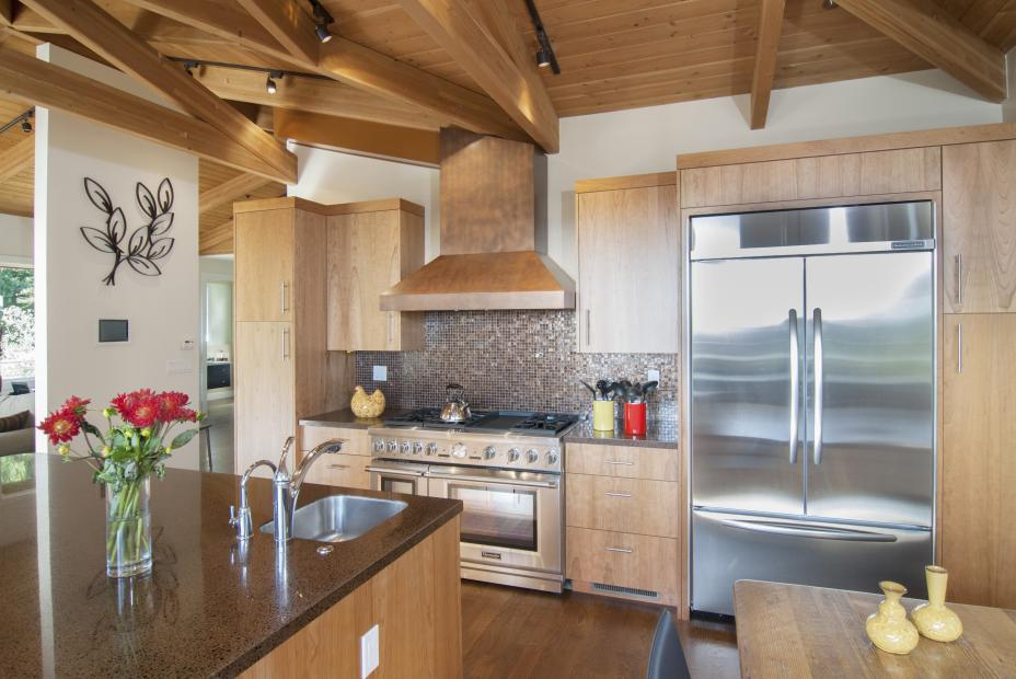 Contemporary Kitchen built in Cherry with a Beautiful Copper Hood Range and Stainless Steel Appliances