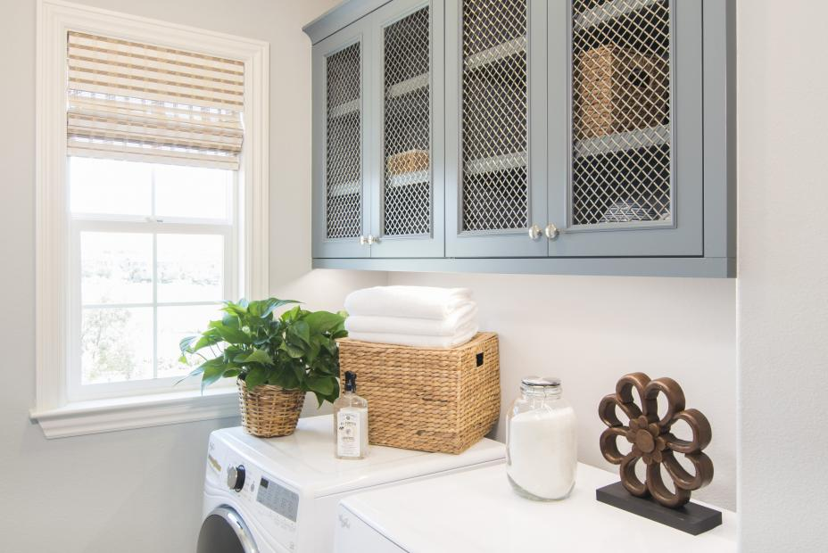 Light Blue Transitional Laundry Room Cabinets with Wire Mesh Grill on Doors and a White Washer - Dryer
