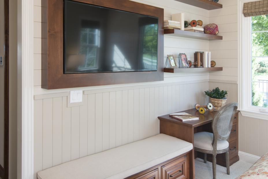 Traditional Bedroom Built-In Desk, Matching Bench Seat, Frame Surrounding a Flat Screen TV and Floating Shelves