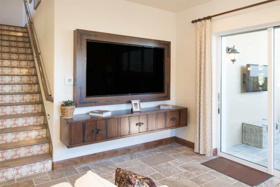 Beautiful Distressed Entertainment Center with Matching TV Frame Surrounding a Black Flat Screen TV