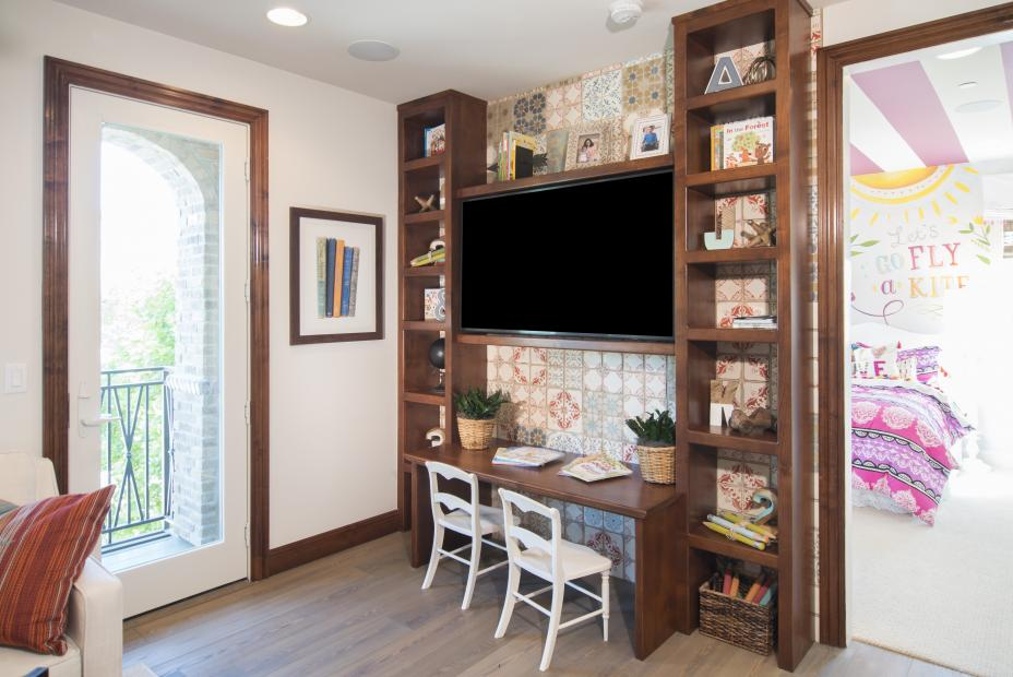 Kid's Playroom Entertainment Center with Open Shelves and a Black Flat Screen TV
