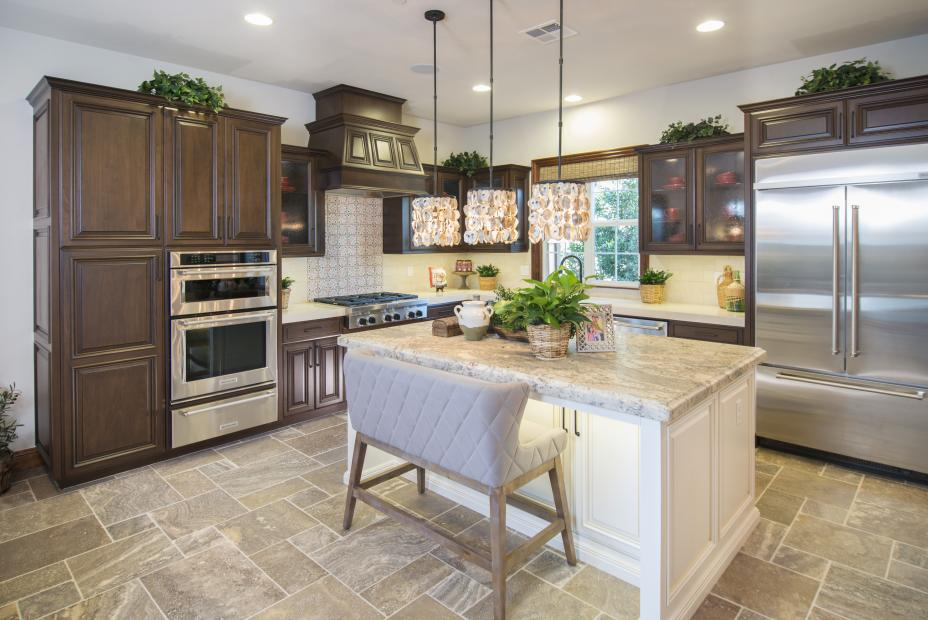 Traditional Walnut Kitchen with a Beautiful Painted Island, Seedy Glass Door Inserts and Stainless Steel Appliances