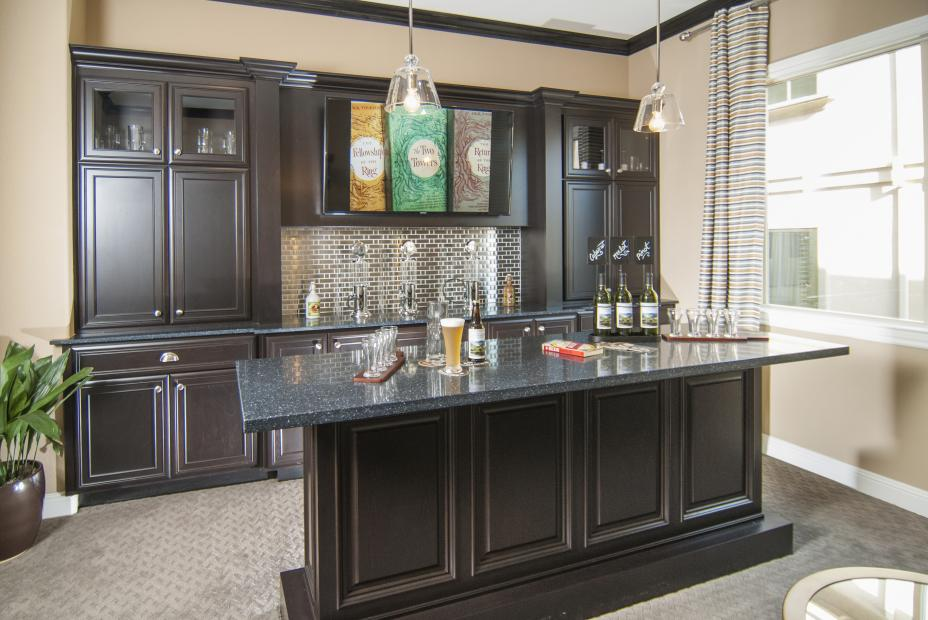 Beautiful Bar Cabinets Stained in a Dark Espresso with Matching Island, Glass Doors and Silver Hardware