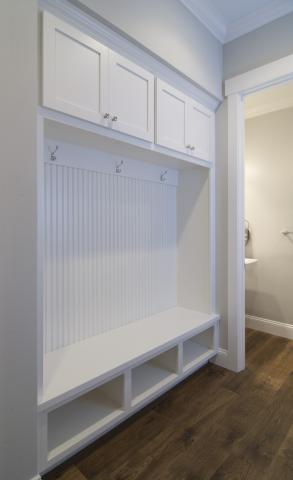 White Transitional Mud Room Built-In with Beadboard Backing, Silver Knobs and Coat Hooks