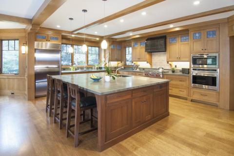 Transitional Kitchen Built in Rift Cut White Oak with a Beautiful Walnut Island, Decorative Glass Doors and Stainless Steel Appliances