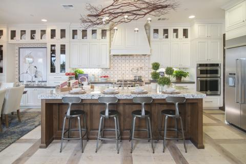 White Traditional Kitchen with a Beautiful Clear Alder Stained Island, Glass Doors and Stainless Steel Appliances