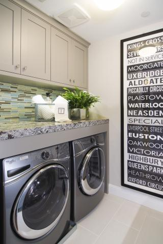 Transitional Painted Beige Laundry Room Cabinets with a Beautiful Granite Counter Top and Whirpool Washer - Dryer
