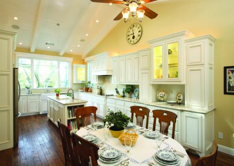 White Transitional Kitchen with Beautiful Glass Doors, Beadboard Backing and Stainless Steel Appliances
