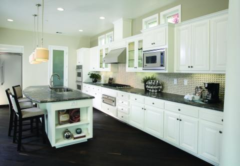 White Traditional Kitchen with Glass Doors, Chrome Hardware and Stainless Steel Appliances