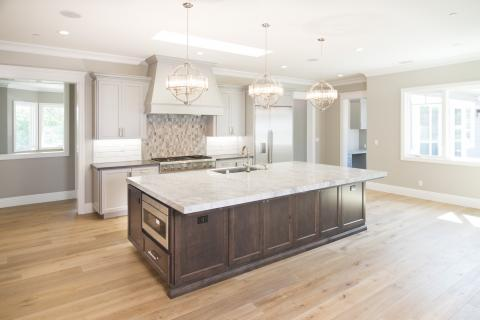 Beautiful Two Toned Transitional Kitchen with Stainless Steel Appliances