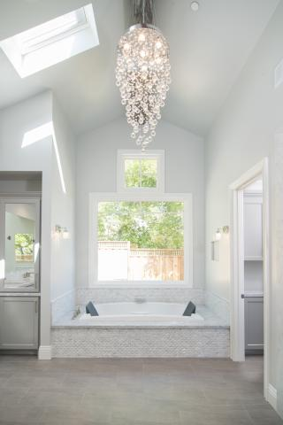 Clean Painted Transitional Master Bathroom with Glass Door and Crystal Chandelier