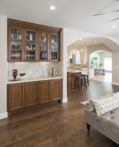 Transitional Stained Bar with Glass Doors