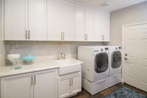 Beautiful White Built-In Laundry Room Cabinets