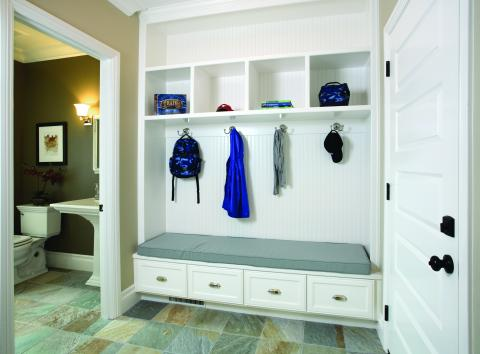 Beautiful White Mudroom with Beadboard Backing, Open Shelves and Silver Hardware