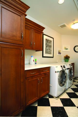 Transitional Stained Laundry Room with a White Marble Countertop, Decorative Hardware, Checkered Flooring and a Samsung Washer - Dryer