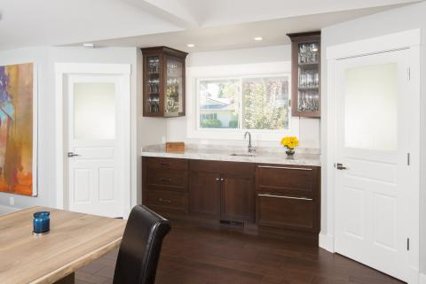 Transitional Stained, Shaker Style Wet Bar Built-In with Glass Doors, a Beautiful Marble Countertop and Chrome Hardware