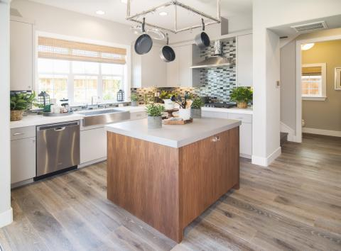Light Grey Contemporary Kitchen with a Beautiful Walnut Island and a Ceiling Pot Rack