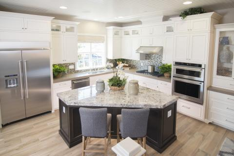 Transitional White Kitchen with a Dark Stained Maple Island, Glass Doors and a Beautiful Granite Counter Tops