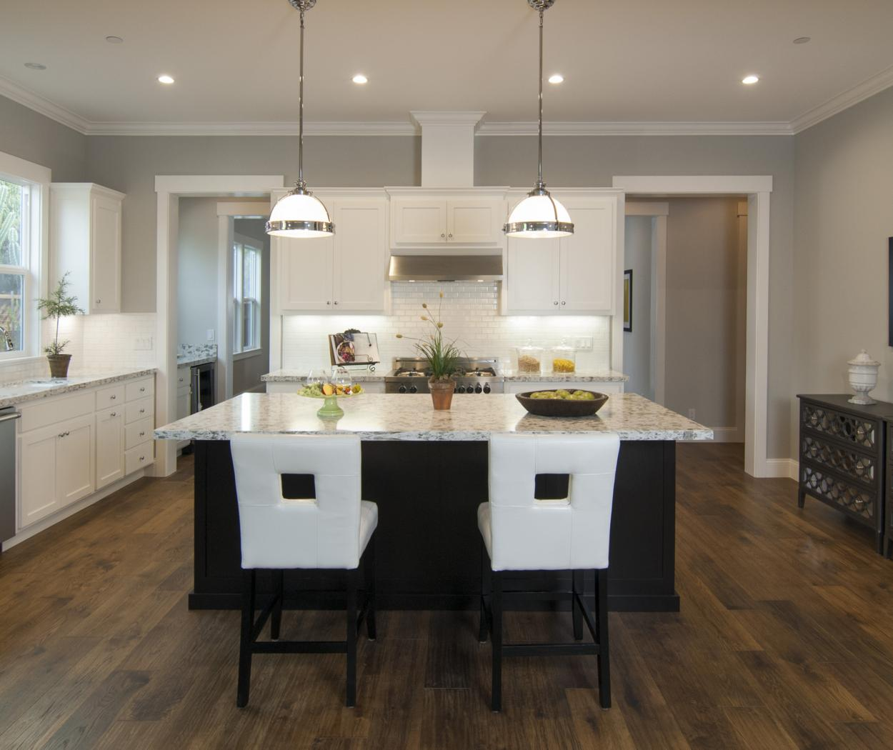 Transitional Shaker Style Kitchen with a Beautiful Espresso Stained Island and Stainless Steel Appliances