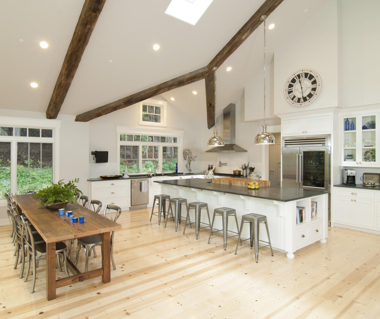 White Transitional Kitchen with a Long Island, Beautiful Wood Beams and a Stainless Steel Hood