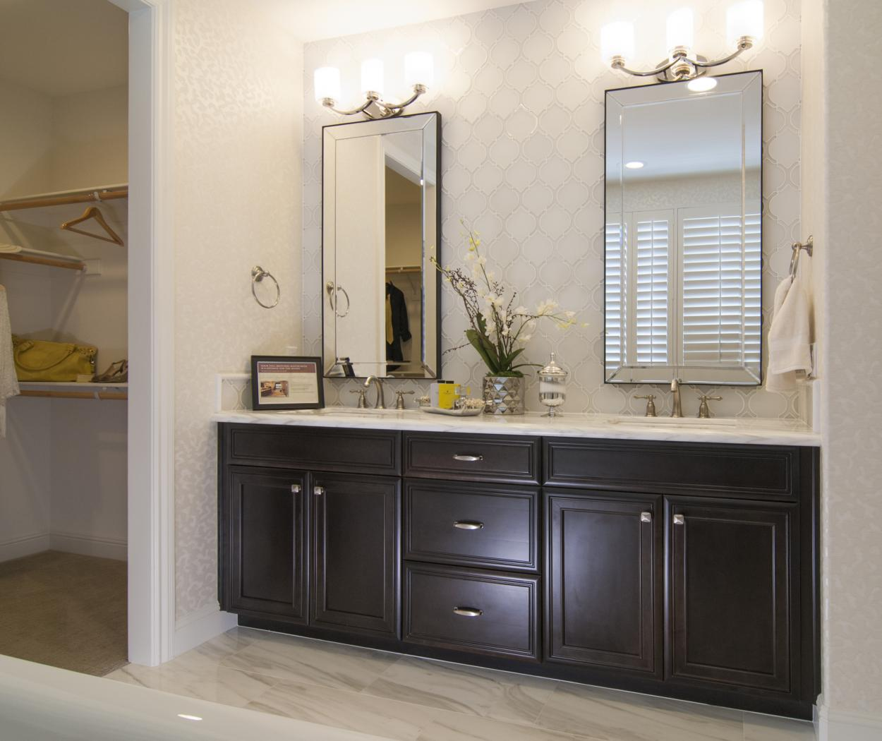 Beautiful Dark Espresso Stained Master Bathroom with Double Sinks, a Marble Counter Top and Silver Hardware