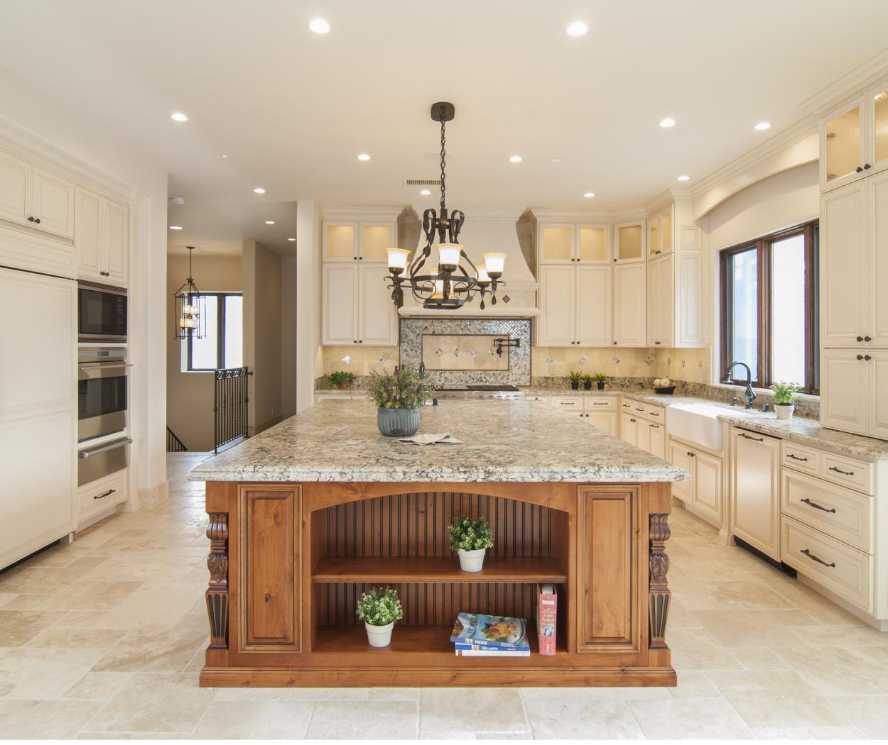 Off White Traditional Kitchen with a Beautiful Stained Island Built in Knotty Alder with Granite Counter Tops, Stainless Steel Appliances and Oil Rubbed Bronze Hardware