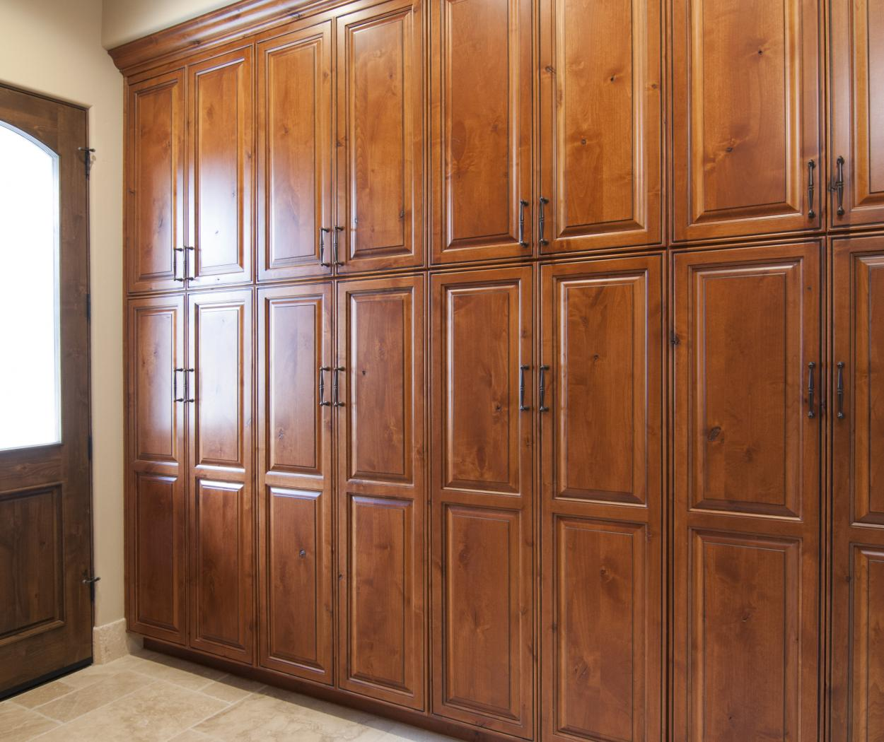 Beautiful Traditional Hallway Ceiling Height Built-Ins with Oil Rubbed Bronze Hardware