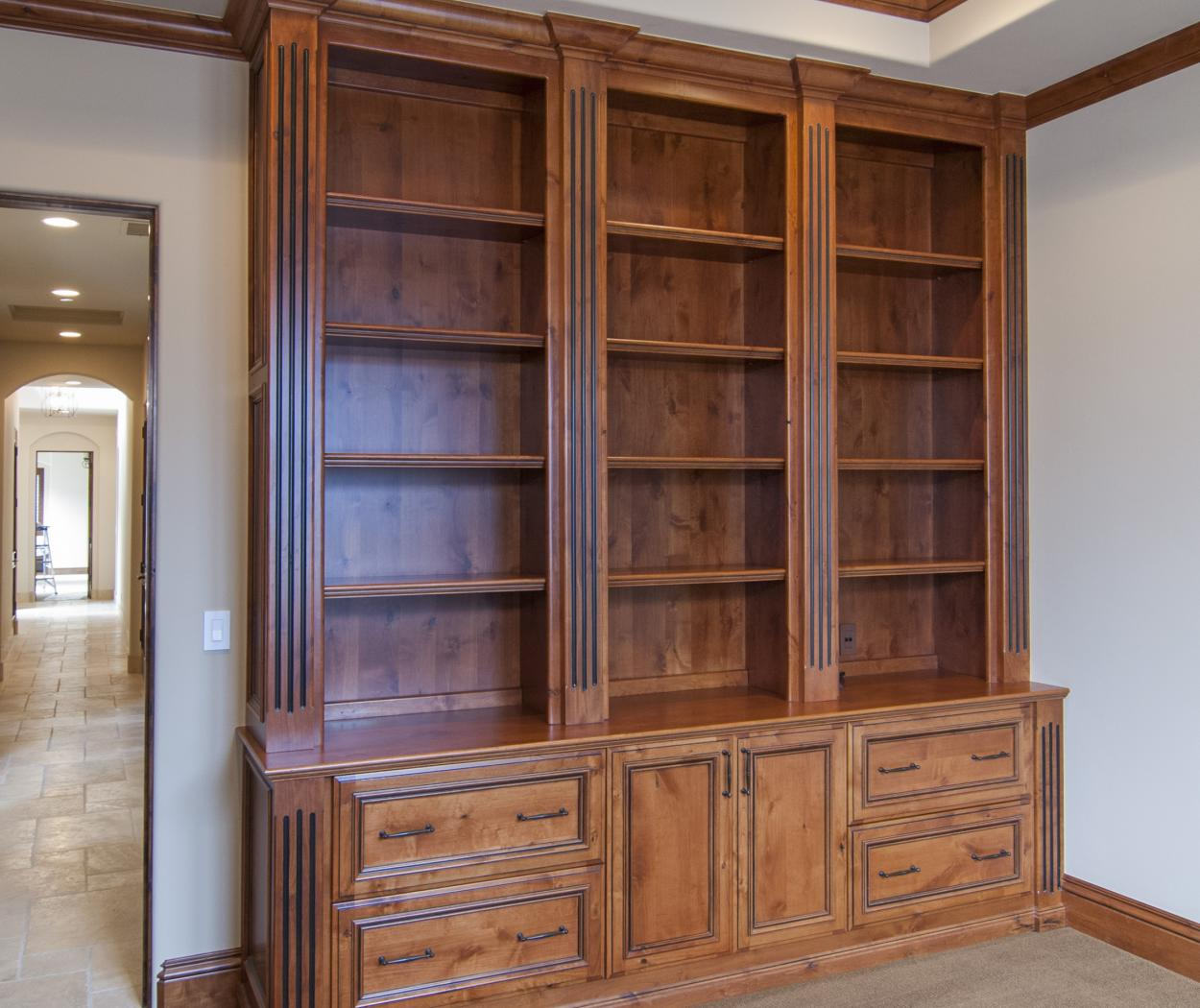 Stained Traditional Office Cabinets Built in Knotty Alder with Open Shelves and Oil Rubbed Bronze Hardware