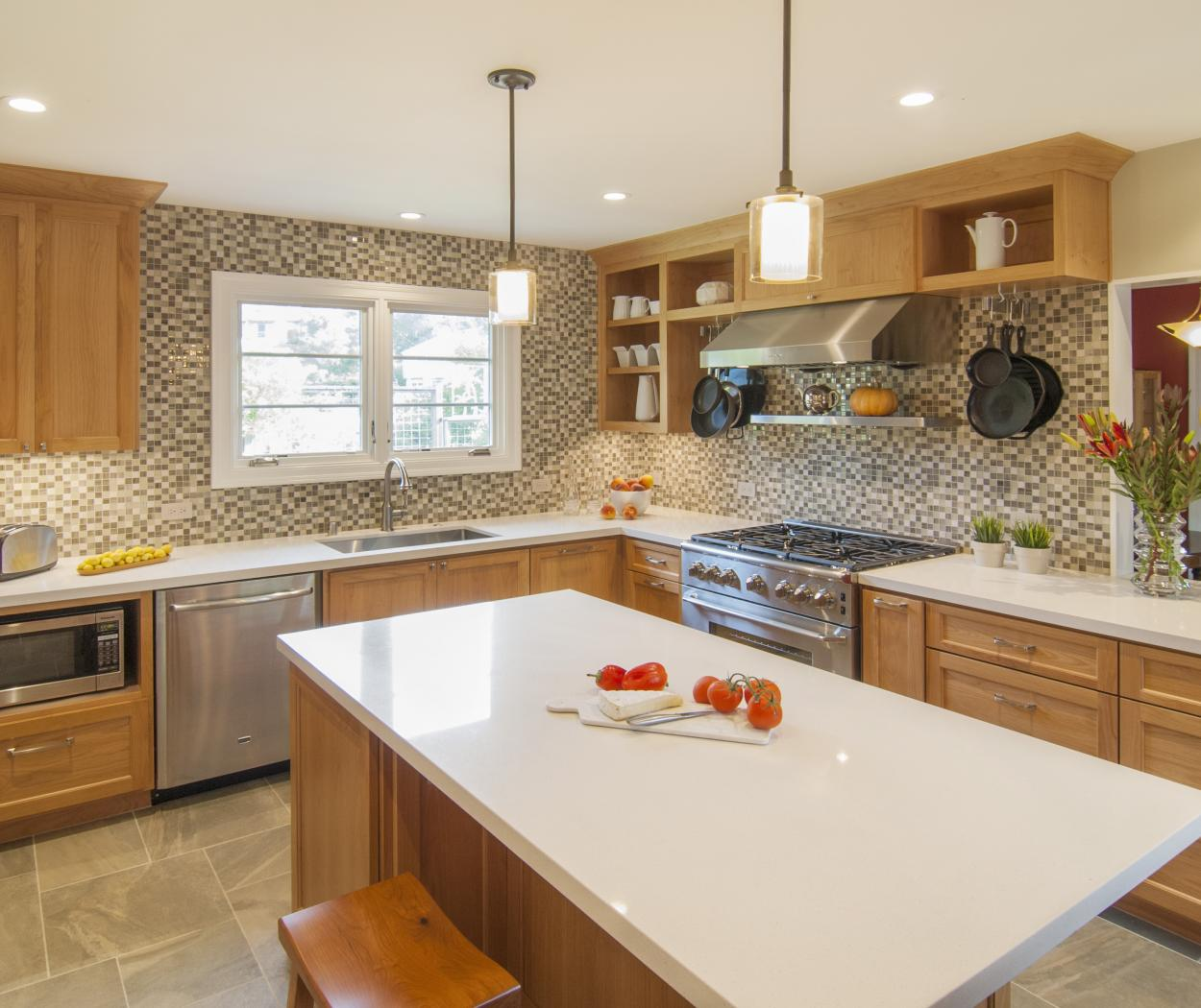 Transitional Stained Kitchen with Open Shelves, White Counter Tops, Stainless Steel Appliances and Hardware