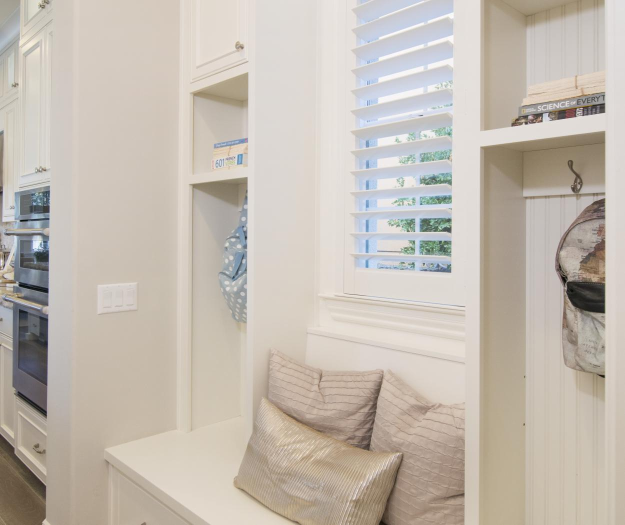 Beautiful Transitional Mud Room with Beadboard Backing and Stainless Steel Hooks