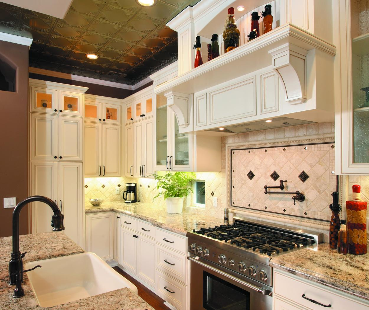 Transitional White Kitchen with Beautiful Glass Doors, Granite Countertops and Stainless Steel Appliances