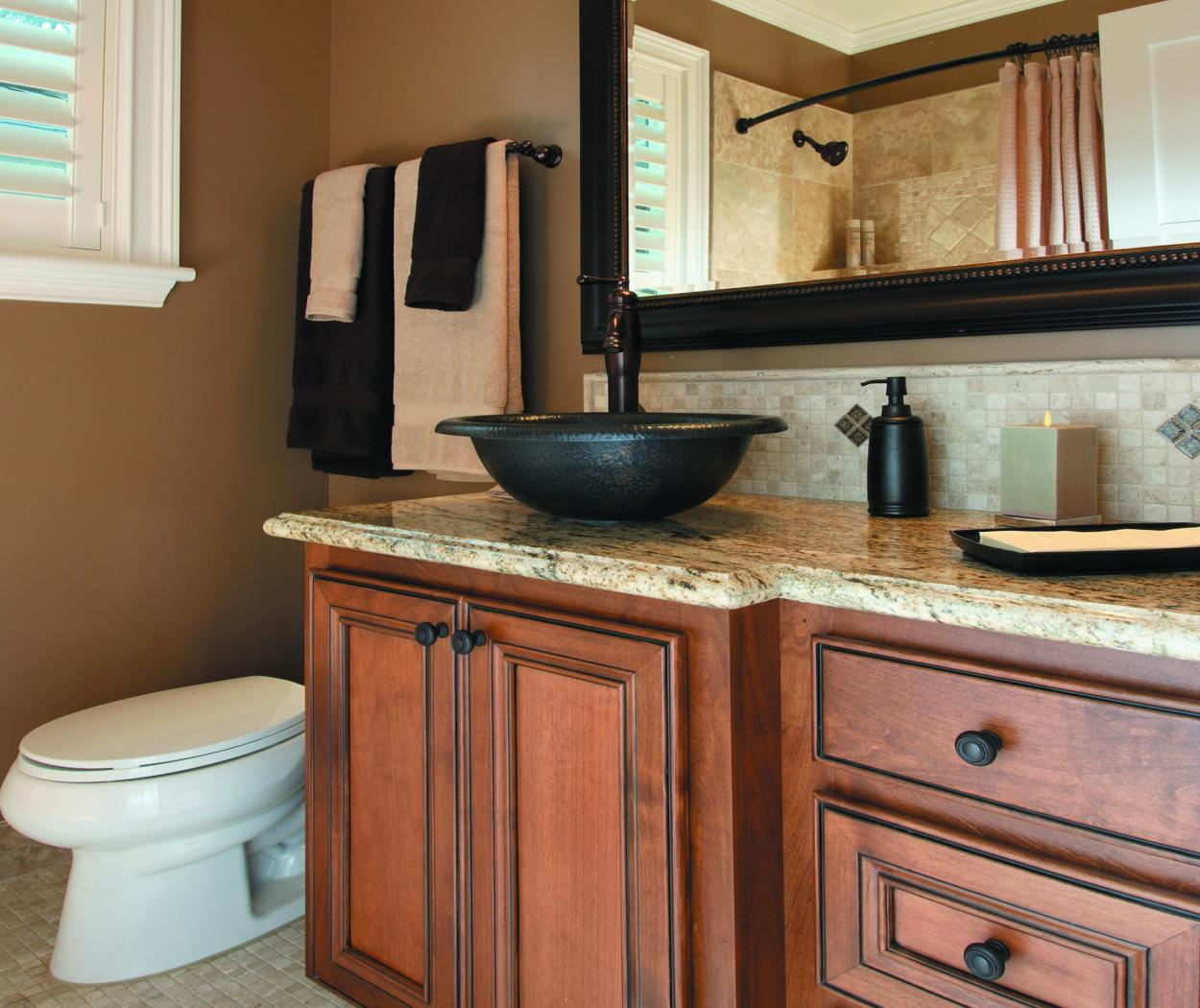 Transitional Bathroom Vanity with a Beautiful Granite Countertop and Oil Rubbed Bronze Hardware