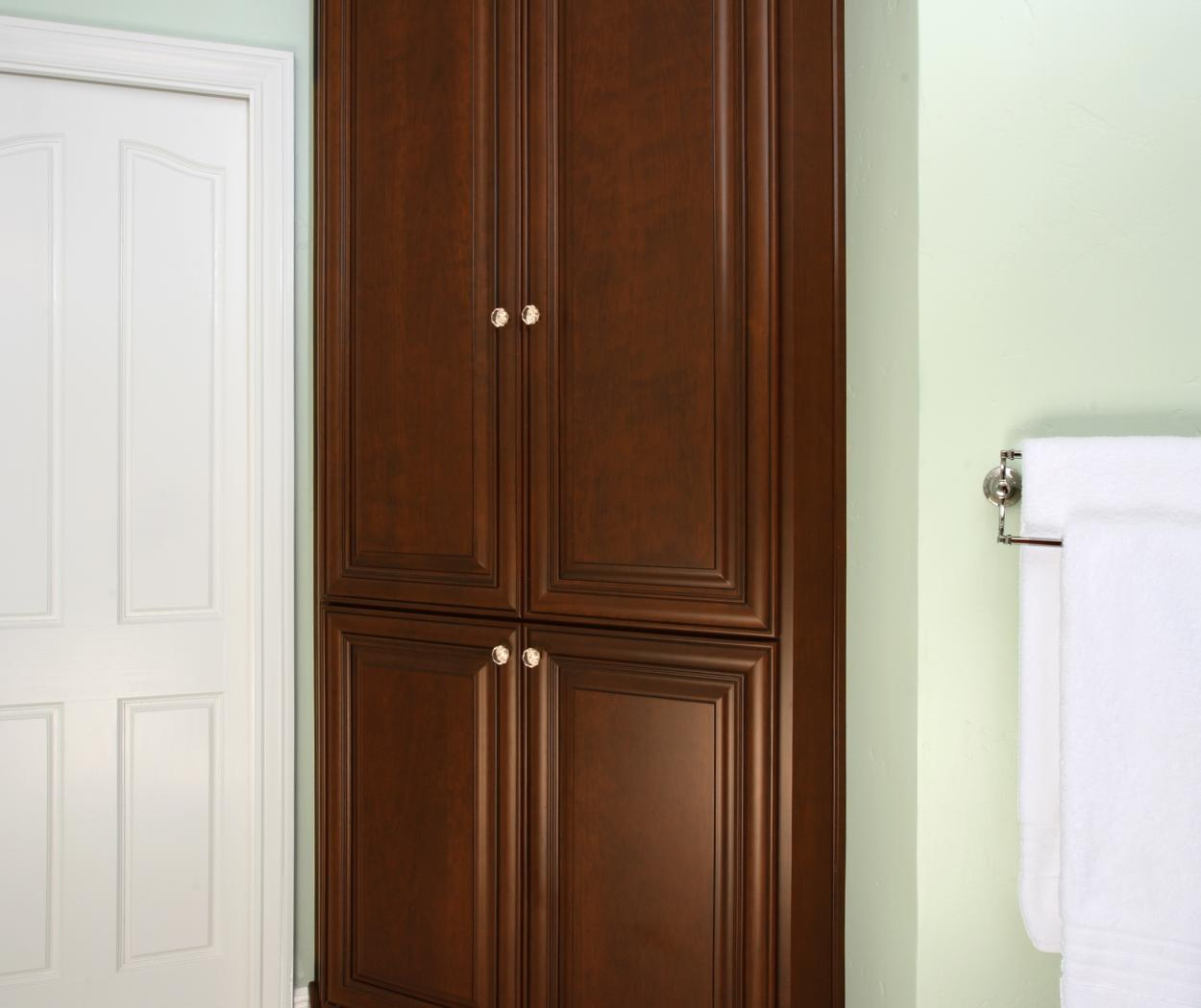 Traditional Chocolate Stained Bathroom Built-In with Diamond Shaped Knobs