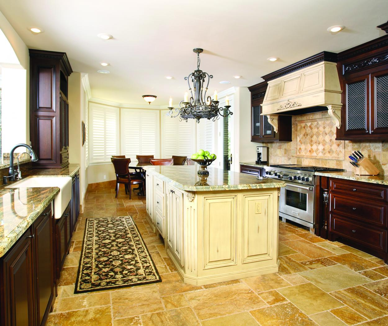 Traditional Stained Kitchen with a Shabby Chic Island and Hood Range, Wire Mesh Doors and Granite Countertops