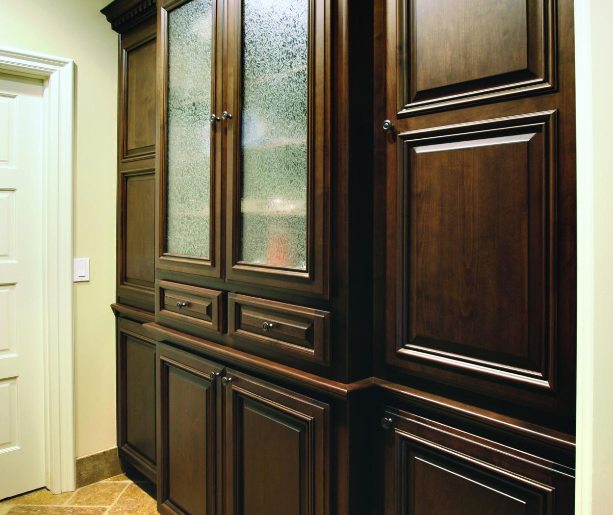 Traditional Chocolate Stained Built-In with Decorative Glass Doors and Oil Rubbed Bronze Hardware