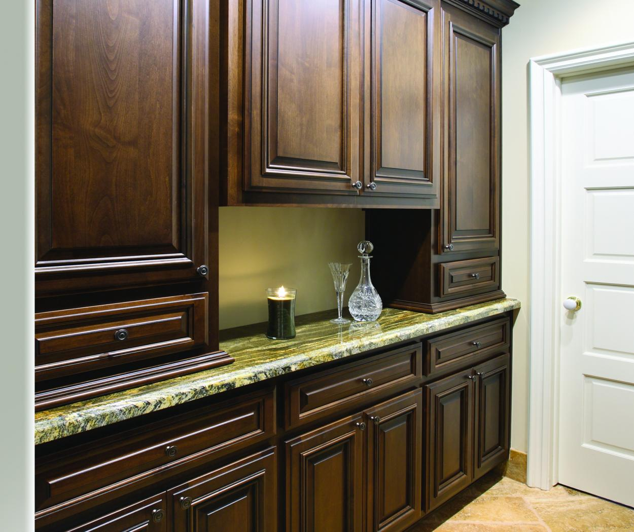 Traditional Chocolate Stained Built-In with a Beautiful Granite Countertop and Oil Rubbed Bronze Hardware