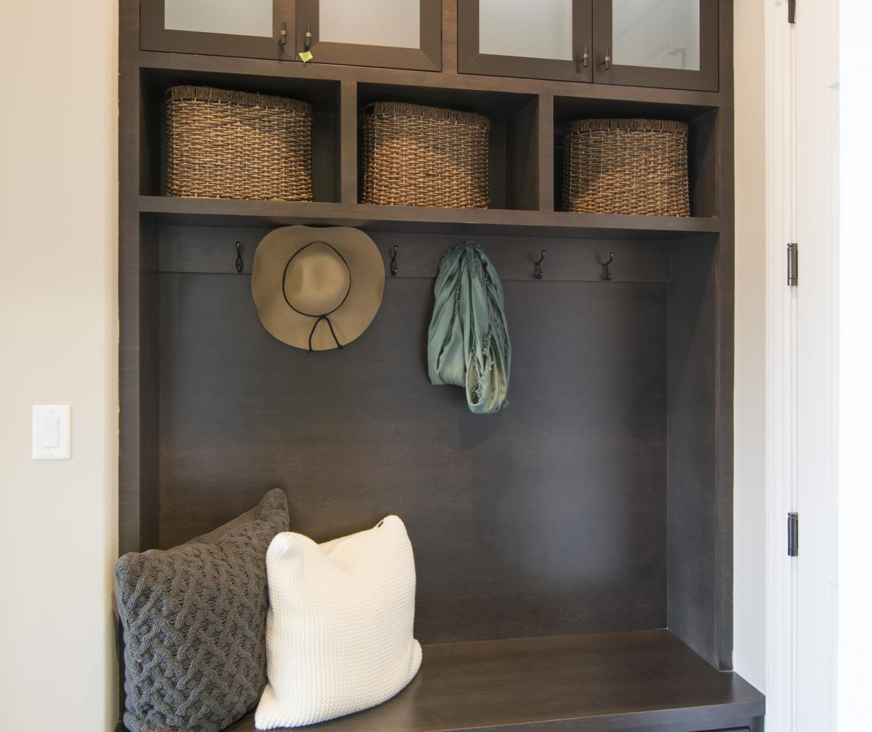 Beautiful Dark Stained Mudroom with Oil Rubbed Bronze Hooks, Glass Doors and Bench Seating