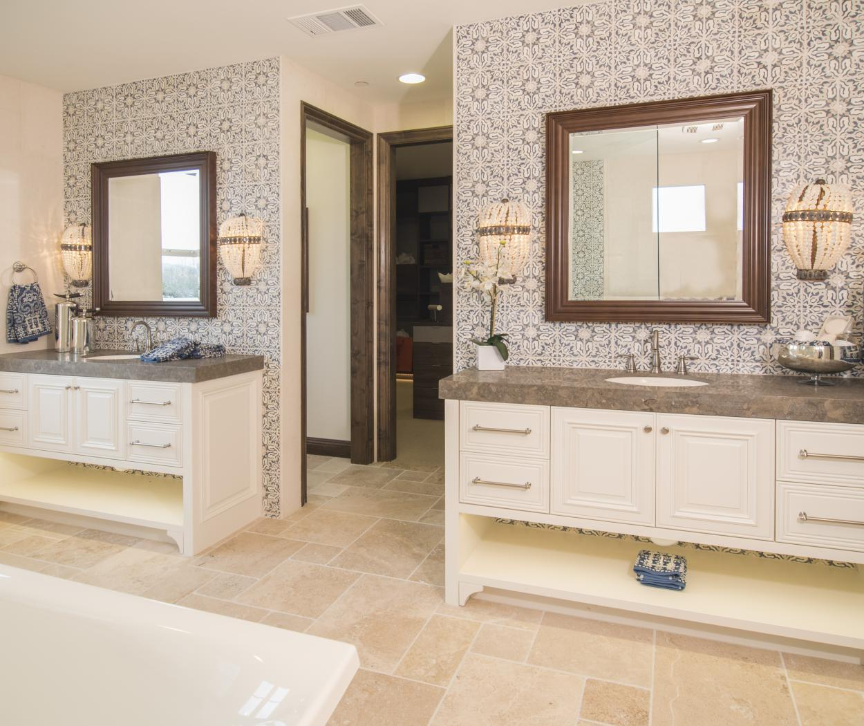 Beautiful White Double Vanity Master Bathroom with LED Under Cabinet Lighting and Granite Counter Tops