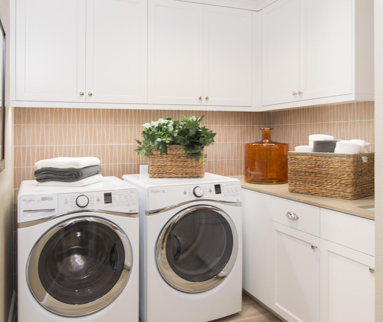 Beautiful White Transitional Laundry Room with a White Washer and Dryer, Silver Knobs and Pulls