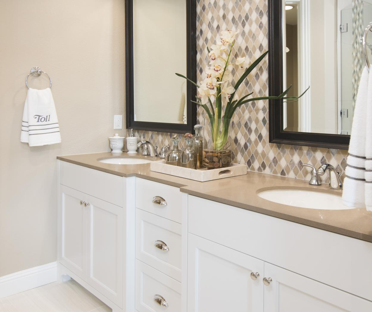 White Master Bathroom with a Tan Counter Top and a Beautiful Checkered Back Spalsh