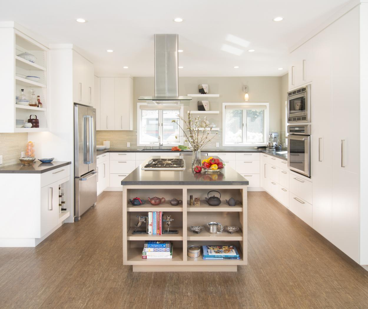 Beautiful White Contemporary Kitchen with an Echo Wood Island, Open Shelves, a Stainless Steel Hood and Silver Pulls