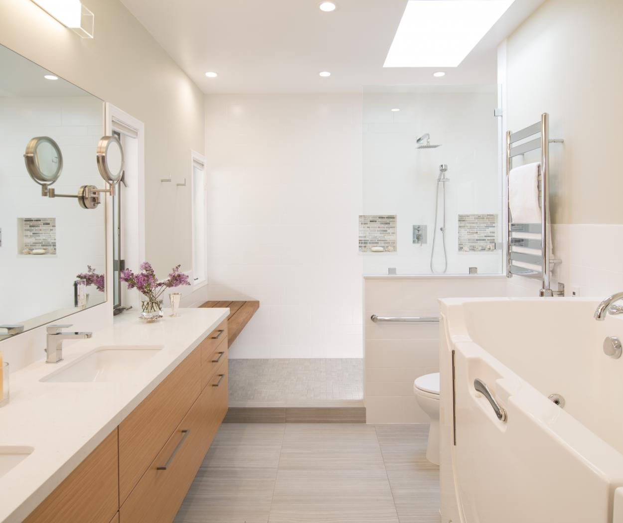 Contemporary Master Bathroom with a Beautiful White Counter Top and Grain Matched Cabinet