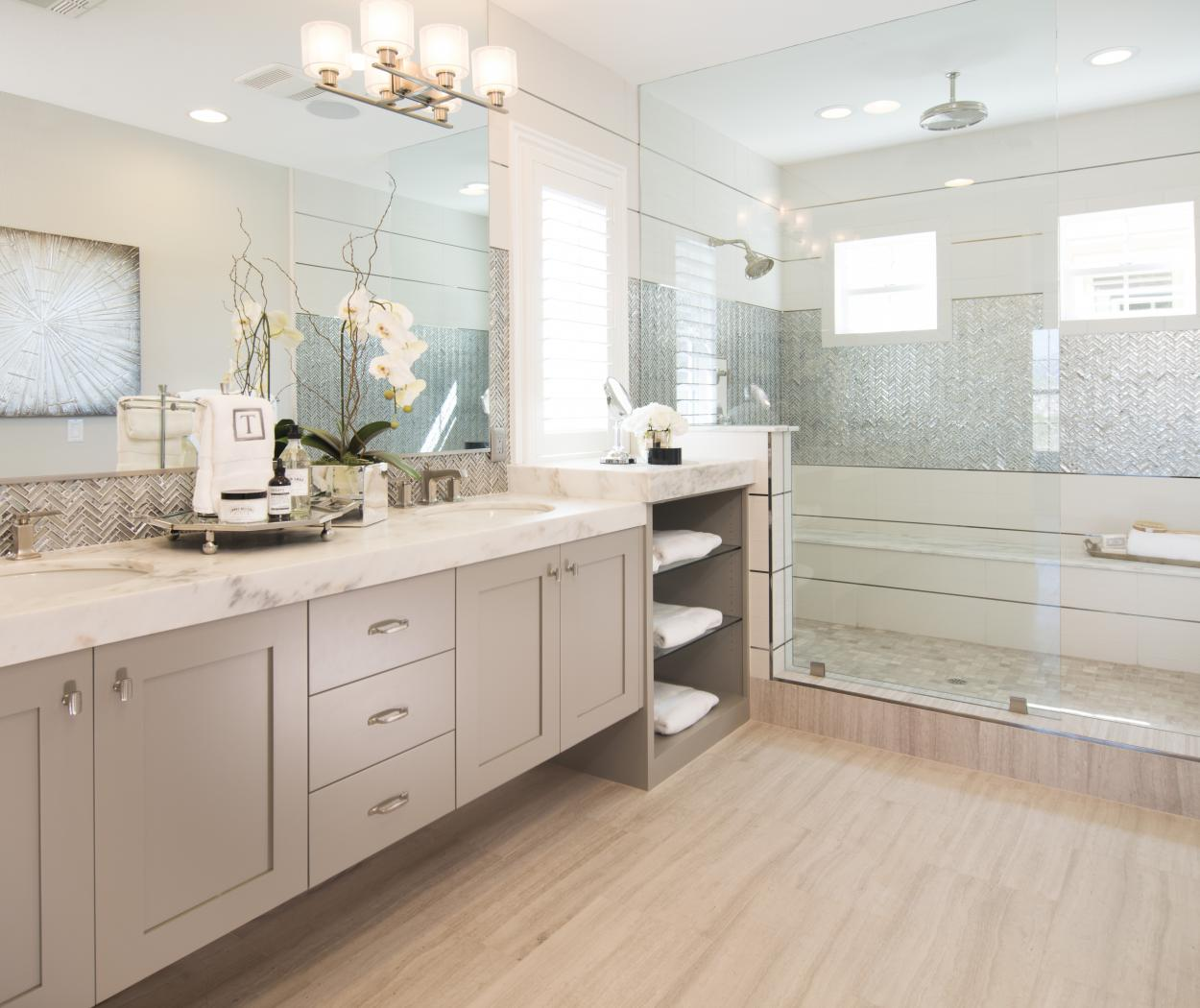 Beautiful Painted Beige, Shaker Style Master Bathroom with Glass Inset Shelves and Silver Knobs - Pulls