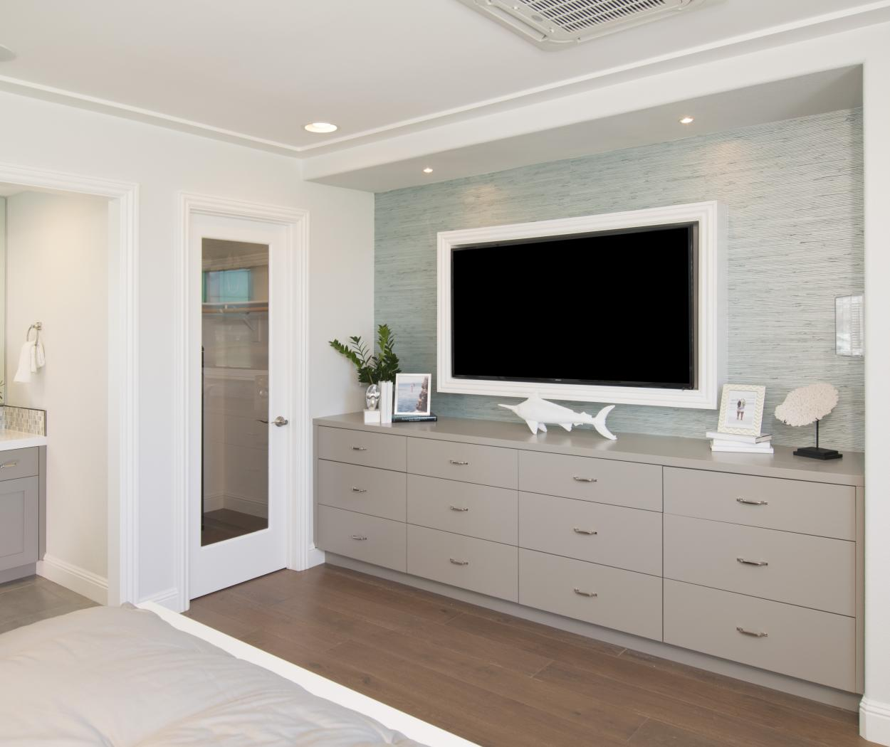Beautiful Master Bedroom with Painted Beige Cabinets and White TV Frame